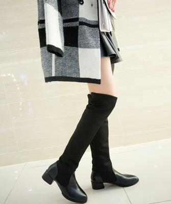 Новая высота: как и с чем носить ботфорты этой осенью